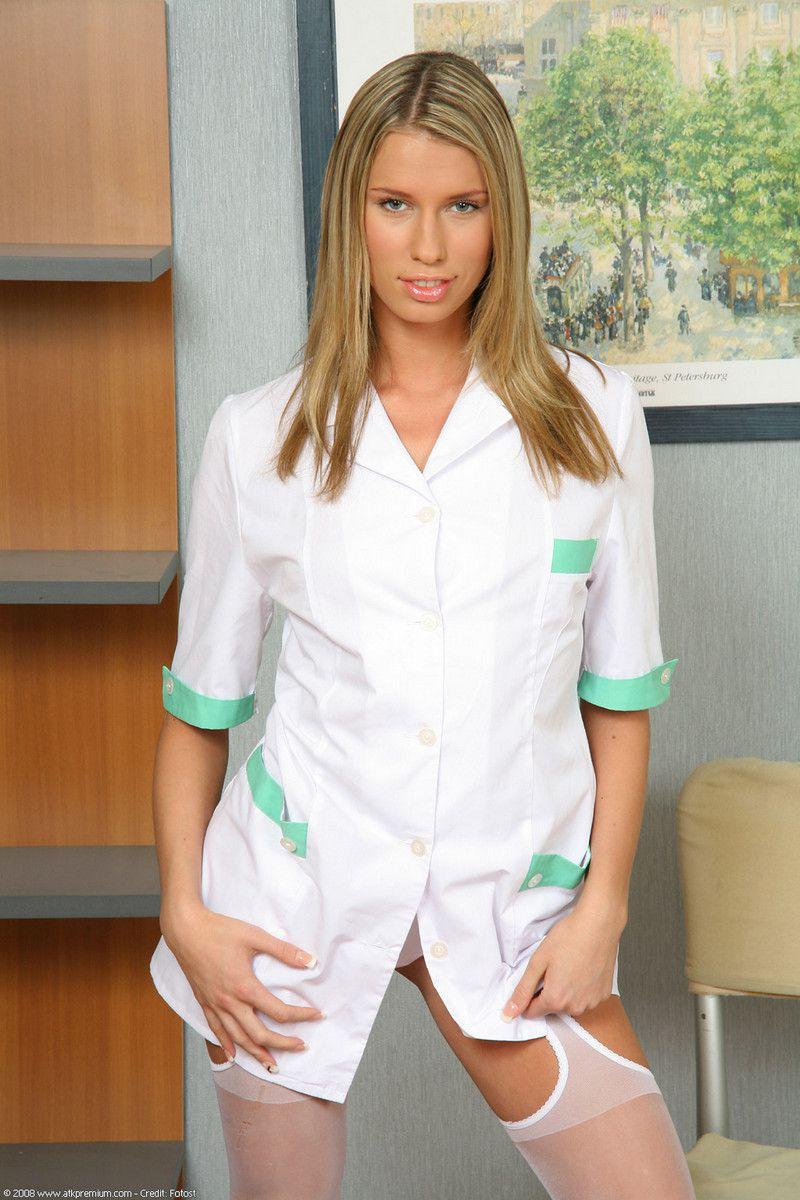 Blondie nurse Natalia unwraps her..